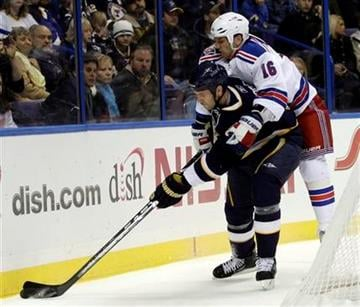New York Rangers' Sean Avery (16) jumps on the back of St. Louis Blues' Eric Brewer (4) as he reaches for the loose puck in the first period of an NHL hockey game, Saturday, Jan. 8, 2011 in St. Louis. (AP Photo/Tom Gannam) By Tom Gannam