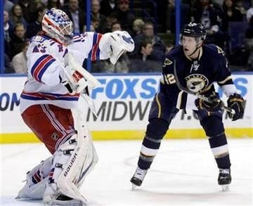 St. Louis Blues' David Backes (42) watches as New York Rangers goalie Martin Biron (43) makes a save with his facemask in the second period of an NHL hockey game, Saturday, Jan. 8, 2011, in St. Louis. (AP Photo/Tom Gannam) By Tom Gannam
