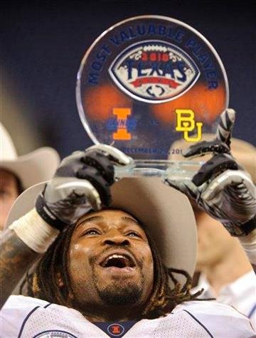 Illinois running back Mikel Leshoure holds up the MVP trophy after the Texas Bowl NCAA college football game against Baylor, Wednesday, Dec. 29, 2010, in Houston. Illinois beat Baylor 38-14. (AP Photo/Dave Einsel) By Dave Einsel