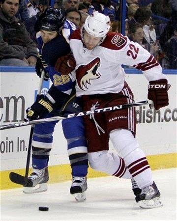 St. Louis Blues' Carlo Colaiacovo, left, and Phoenix Coyotes' Lee Stempniak chase a loose puck during the first period of an NHL hockey game Monday, Jan. 10, 2011, in St. Louis. (AP Photo/Jeff Roberson) By Jeff Roberson