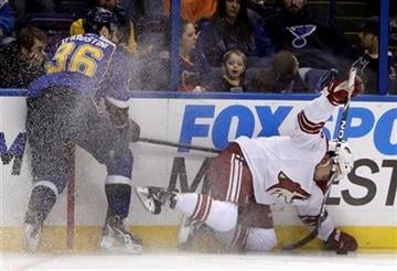 Phoenix Coyotes' Sami Lepisto, of Finland, and St. Louis Blues' Matt D'Agostini, left, chase the puck along the boards during the second period of an NHL hockey game Monday, Jan. 10, 2011, in St. Louis. (AP Photo/Jeff Roberson) By Jeff Roberson
