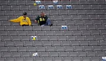 Oregon fans sit in their seats after the BCS National Championship NCAA college football game against Auburn Monday, Jan. 10, 2011, in Glendale, Ariz. Auburn won 22-19. (AP Photo/Charlie Riedel) By Charlie Riedel