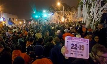 Thousands of Auburn Tiger fans gather to roll Toomer's Corner in Auburn, Ala., Monday, Jan. 10, 2011 following a 22-19 Auburn win over the Oregon Ducks in the BCS championship game.  (AP Photo/Dave Martin) By Dave Martin