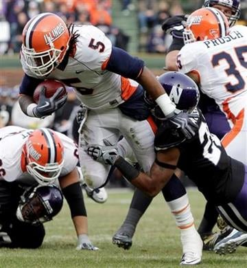 Northwestern's Justan Vaughn, right, tackles Illinois running back Mikel Leshoure during the first quarter of an NCAA college football game at Wrigley Field in Chicago on Saturday, Nov. 20, 2010. (AP Photo/Nam Y. Huh) By Nam Y. Huh