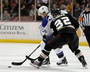 St. Louis Blues center Jay McClement (18) controls the puck as Anaheim Ducks' Toni Lydman (32), of Finland, defends in the first period of an NHL hockey game in Anaheim, Calif., Wednesday, Jan. 12, 2011. (AP Photo/Alex Gallardo) By Alex Gallardo