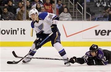 St. Louis Blues right wing Matt D'Agostini, left, looks to shoot as  Los Angeles Kings' Willie Mitchell defends during the third period of an NHL hockey game in Los Angeles, Thursday, Jan. 13, 2011. The Blues won 3-1. (AP Photo/Jae C. Hong) By Jae C. Hong