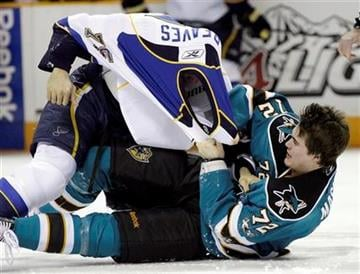 San Jose Sharks center Brandon Mashinter (72) fights with St. Louis Blues right wing Ryan Reaves (75) during the first period of an NHL hockey game in San Jose, Calif., Saturday, Jan. 15, 2011. (AP Photo/Marcio Jose Sanchez) By Marcio Jose Sanchez