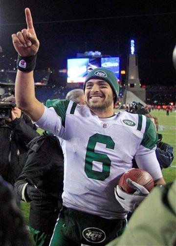 New York Jets quarterback Mark Sanchez celebrates his team's 28-21 win over the New England Patriots in an NFL divisional playoff football game in Foxborough, Mass., Sunday, Jan. 16, 2011. (AP Photo/Charles Krupa) By Charles Krupa
