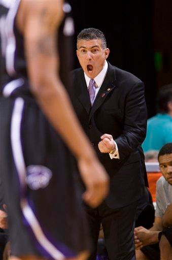 Kansas State head coach Frank Martin yells encouragement to his team during the first half of an NCAA college basketball game against Missouri Monday, Jan. 17, 2011, in Columbia, Mo. (AP Photo/L.G. Patterson) By L.G. Patterson