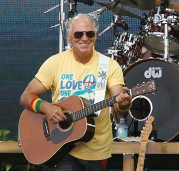 Jimmy Buffett performs Sunday, July 11, 2010 in Gulf Shores, Ala. The free concert attended by tens of thousands of people was meant to help the Gulf Coast through the oil spill crisis. (AP Photo/Mobile Press-Register, Chip English) By Chip English