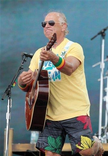 Jimmy Buffett performs on the beach at Gulf Shores, Ala., Sunday July 11, 2010 at a free show to boost spirits and lure visitors to the coast during the Gulf oil spill. (AP Photo/Jamie Martin) By Jamie Martin