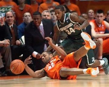 Illinois' Demetri McCamey (32) dives and saves the ball as Michigan State Korie Luscious (34) defends during the first half of an NCAA college basketball game Tuesday, Jan. 18, 2011, in Champaign, Ill. (AP Photo/Robert K. O'Daniell) By Robert K. O'Daniell