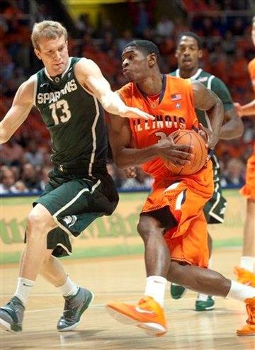 Michigan State's Austin Thornton (13) tries to stop Illinois' Brandon Paul (3) on a fast break during the first half of an NCAA college basketball game Tuesday, Jan. 18, 2011, in Champaign, Ill. (AP Photo/Robert K. O'Daniell) By Robert K. O'Daniell
