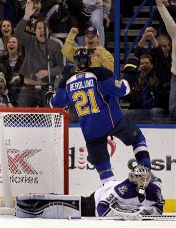 St. Louis Blues' Patrik Berglund (21), of Sweden, celebrates after scoring past Los Angeles Kings goalie Jonathan Quick, bottom, during the first period of an NHL hockey game Tuesday, Jan. 18, 2011, in St. Louis. (AP Photo/Jeff Roberson) By Jeff Roberson