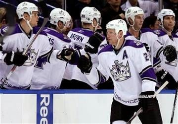 Los Angeles Kings' Matt Greene (2) is congratulated by teammates after scoring during the second period of an NHL hockey game against the St. Louis Blues on Tuesday, Jan. 18, 2011, in St. Louis. (AP Photo/Jeff Roberson) By Jeff Roberson