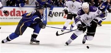 St. Louis Blues' Vladimir Sobotka, left, of the Czech Republic, and Los Angeles Kings' Trevor Lewis chase a loose puck during the second period of an NHL hockey game Tuesday, Jan. 18, 2011, in St. Louis. (AP Photo/Jeff Roberson) By Jeff Roberson