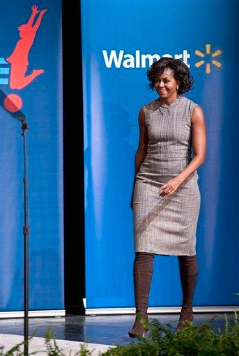 First lady Michelle Obama arrives for a Wal-Mart announcement of a comprehensive effort to provide healthier and more affordable food choices to their customers, Thursday, Jan. 20, 2011, in Washington. (AP Photo/Cliff Owen) By Cliff Owen