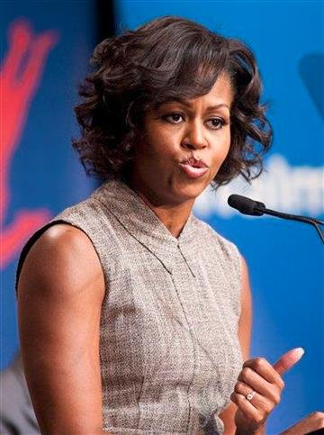 First lady Michelle Obama takes part in Wal-Mart's announcement of a comprehensive effort to provide healthier and more affordable food choices to their customers, Thursday, Jan. 20, 2011, in Washington. (AP Photo/Cliff Owen) By Cliff Owen