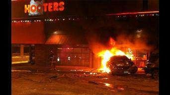 This January 20, 2010 photo shows a car ablaze after crashing into the Hooters restaurant in downtown St. Louis. By KMOV Web Producer