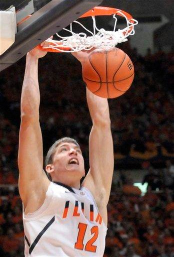 ** CORRECTS YEAR ** Illinois' Illinois' center Meyers Leonard (12) dunks against Ohio State during an NCAA college basketball game at the Assembly Hall in Champaign, Ill. on Saturday, Jan. 22, 2011.(AP Photo/Robin Scholz) By Robin Scholz