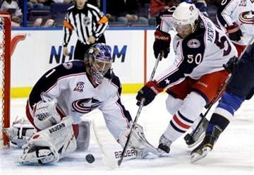 Columbus Blue Jackets goalie Steve Mason, left, and Antoine Vermette work to clear a loose puck during the second period of an NHL hockey game against the St. Louis Blues, Saturday, Jan. 22, 2011, in St. Louis. (AP Photo/Jeff Roberson) By Jeff Roberson