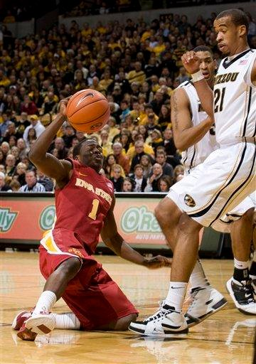 Iowa State's Bubu Palo, left, slips as he falls to the court in front of Missouri's Laurence Bowers, right, during the first half of an NCAA college basketball game, Saturday, Jan. 22, 2011, in Columbia. Mo. (AP Photo/L.G. Patterson) By L.G. Patterson