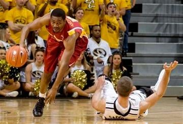 """Iowa State's Darion """"Jake"""" Anderson, left, stumbles as he is fouled by Missouri's Justin Safford, right, during the first half of an NCAA college basketball game, Saturday, Jan. 22, 2011, in Columbia. Mo. (AP Photo/L.G. Patterson) By L.G. Patterson"""