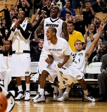 The Missouri bench celebrates after a basket late in their 87-54 victory over Iowa State during the second half of an NCAA college basketball game, Saturday, Jan. 22, 2011, in Columbia. Mo. (AP Photo/L.G. Patterson) By L.G. Patterson