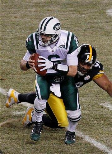 New York Jets quarterback Mark Sanchez avoids the rush by Pittsburgh Steelers defensive tackle Casey Hampton (98) during the first half of the AFC Championship NFL football game in Pittsburgh, Sunday, Jan. 23, 2011. (AP Photo/Matt Slocum) By Matt Slocum