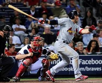 St. Louis Cardinals' Nick Punto connects to hit two runs in to go ahead against the Atlanta Braves during the 11th inning of an MLB baseball game, Friday, April 29, 2011, in Atlanta. St. Louis won 5-3. (AP Photo/John Amis) By John Amis
