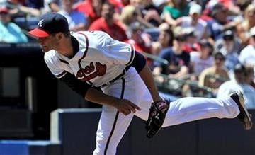 Atlanta Braves pitcher Brandon Beachy throws against the Saint Louis Cardinals during the seventh inning of a baseball game, Saturday, April 30, 2011, in Atlanta. (AP Photo/John Amis) By John Amis