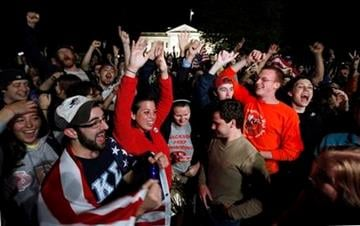 A crowd outside the White House in Washington, cheer Sunday, May 1, 2011, upon hearing the news that terrorist leader Osama bin Laden is dead. (AP Photo/Manuel Balce Ceneta) By Manuel Balce Ceneta