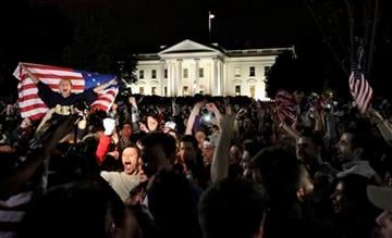 A crowd outside the White House in Washington, cheers Sunday, May 1, 2011, upon hearing the news that terrorist leader Osama bin Laden is dead. (AP Photo/Manuel Balce Ceneta) By Manuel Balce Ceneta