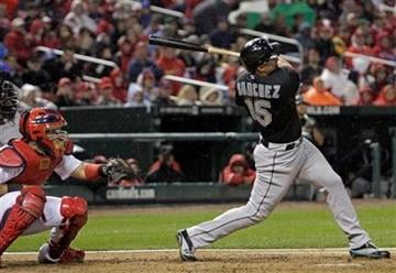 Florida Marlins' Gaby Sanchez (15) connects for a grand slam as St. Louis Cardinals catcher Yadier Molina (4) watches in the third inning of a baseball game, Monday, May 2, 2011 in St. Louis.(AP Photo/Tom Gannam) By Tom Gannam