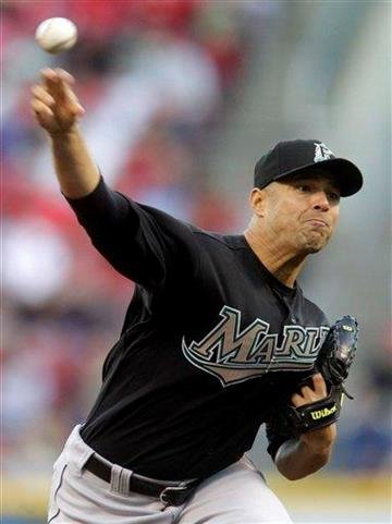 Florida Marlins starting pitcher Javier Vazquez throws against the Cincinnati Reds in the first inning of a major league baseball game on Friday, April 29, 2011, in Cincinnati. (AP Photo/Al Behrman) By Al Behrman