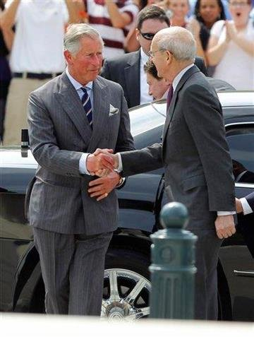 Britain's Prince Charles, left, shakes hands with Supreme Court Justice Stephen Breyer as he arrives at the Supreme Court in Washington, Tuesday, May 3, 2011. (AP Photo/Alex Brandon) By Alex Brandon