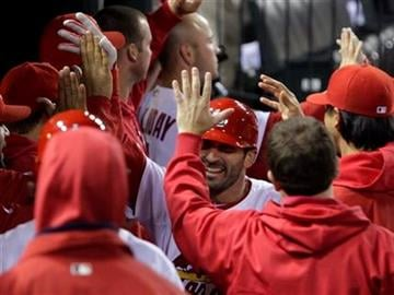 St. Louis Cardinals' Daniel Descalso celebrates in the dugout after hitting a three-run home run in the seventh inning of a baseball game against the Florida Marlins, Tuesday, May 3, 2011 in St. Louis. (AP Photo/Tom Gannam) By Tom Gannam