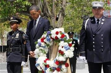 President Barack Obama pauses after laying a wreath at the National Sept. 11 Memorial at Ground Zero in New York, Thursday, May 5, 2011. (AP Photo/Charles Dharapak) By Charles Dharapak