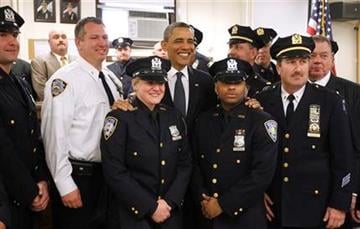 President Barack Obama meets with police officers and first responders at the First Precinct before visiting the National Sept. 11 Memorial at Ground Zero in New York, Thursday, May 5, 2011. (AP Photo/Charles Dharapak) By Charles Dharapak