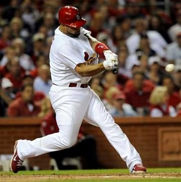 St. Louis Cardinals' Albert Pujols connects on a two-run single against the Milwaukee Brewers in the forth inning in a baseball game on Friday, May 6, 2011, in St. Louis. (AP Photo/Bill Boyce) By Bill Boyce