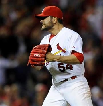 St. Louis Cardinals' starting pitcher Jaime Garcia (54) celebrates his two-hit shutout against the Milwaukee Brewers in a baseball game on Friday, May 6, 2011, in St. Louis.The Cardinals won 6-0. (AP Photo/Bill Boyce) By Bill Boyce