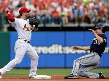 St. Louis Cardinals' Nick Punto, left, forces out Milwaukee Brewers' Craig Counsell (30) but fails to turn a double play in the first inning of a baseball game on Saturday, May 7, 2011, in St. Louis. (AP Photo/Bill Boyce) By Bill Boyce