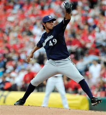 Milwaukee Brewers' starting pitcher Yovani Gallardo (49) throws against the St. Louis Cardinals in the first inning in a baseball game on Saturday, May 7, 2011, in St. Louis. (AP Photo/Bill Boyce) By Bill Boyce