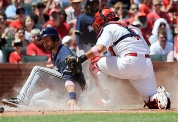 Milwaukee Brewers' Jonathan Lecroy, left, is tagged out at home by St. Louis Cardinals' Yadier Molina (4) in the fourth inning in a baseball game Sunday, May 8, 2011, in St. Louis. (AP Photo/Bill Boyce) By Bill Boyce