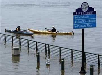Kayakers paddle the Mississippi River floodwaters near the base of Beale Street on Sunday, May 8, 2011, in Memphis, Tenn. The river is expected to crest Tuesday. (AP Photo/Mark Humphrey) By Mark Humphrey