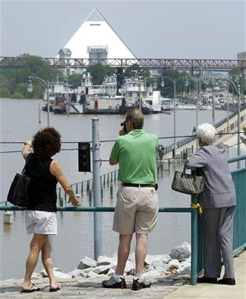 People look at Mississippi River floodwaters on Sunday, May 8, 2011, in Memphis, Tenn. The river is expected to crest Tuesday. In the background is the Pyramid arena. (AP Photo/Mark Humphrey) By Mark Humphrey