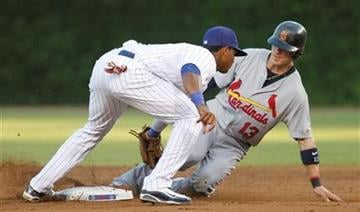St. Louis Cardinals' Brendan Ryan, right, steals second base as Chicago Cubs shortstop Starlin Castro applies a late tag during the second inning of a baseball game Sunday, July 25, 2010, in Chicago. (AP Photo/Nam Y. Huh) By Nam Y. Huh