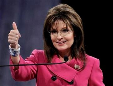 Former Republican vice presidential candidate Sarah Palin gestures while addressing the National Quartet Convention in Louisville, Ky., Thursday, Sept. 16, 2010.  (AP Photo/Ed Reinke) By Ed Reinke