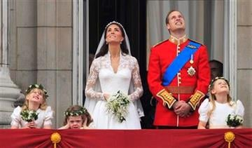 Britain's Prince William and his wife Kate, Duchess of Cambridge watch a fly past of military planes from the balcony of Buckingham Palace after the Royal Wedding in London Friday, April, 29, 2011. (AP Photo/Matt Dunham) By Matt Dunham