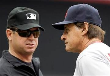 St. Louis Cardinals manager Tony LaRussa, right, talks with third base umpire Rob Drake, left, in the third inning of a baseball game against the Cincinnati Reds, Sunday, May 16, 2010, in Cincinnati. (AP Photo/Al Behrman) By Al Behrman